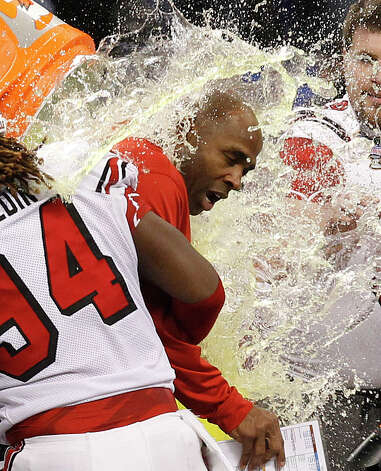 Louisville head coach Charlie Strong is dunked by his team following a 33-23 win over Florida in the Sugar Bowl NCAA college football game Wednesday, Jan. 2, 2013, in New Orleans. Photo: Butch Dill, Associated Press / FR111446 AP