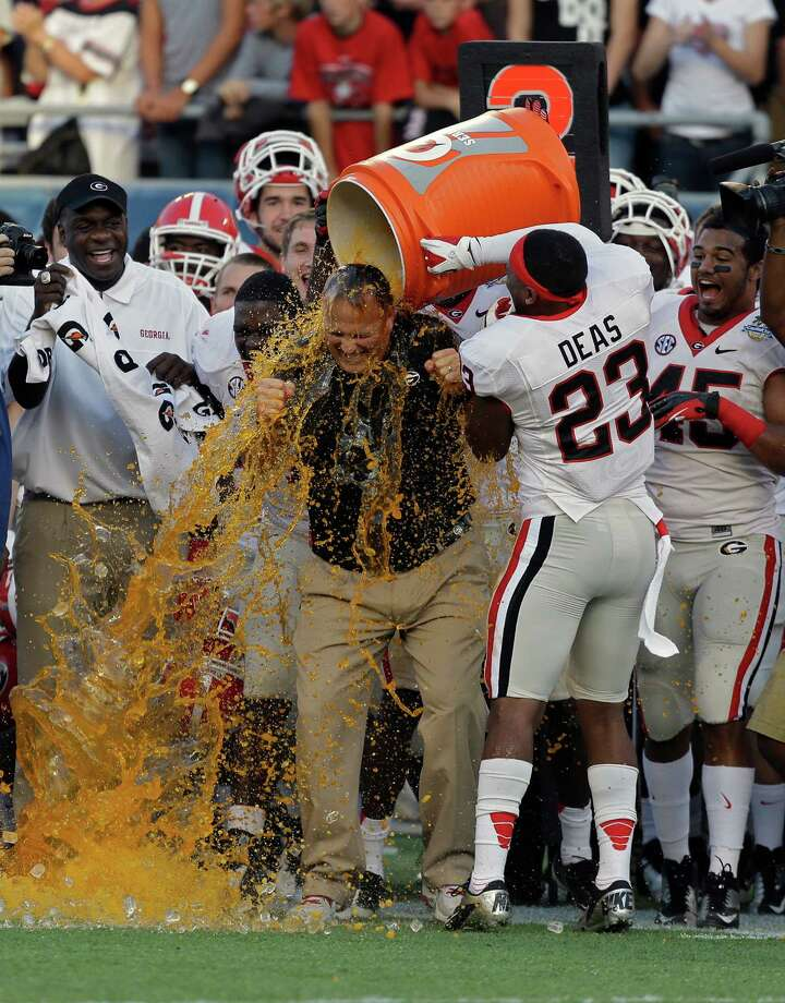 Georgia head coach Mark Richt, center, is doused by his players including free safety Marc Deas (23) during the final seconds of the Capital One Bowl NCAA football game against Nebraska, Tuesday, Jan. 1, 2013, in Orlando, Fla. Georgia won the game 45-31. Photo: John Raoux, Associated Press / AP