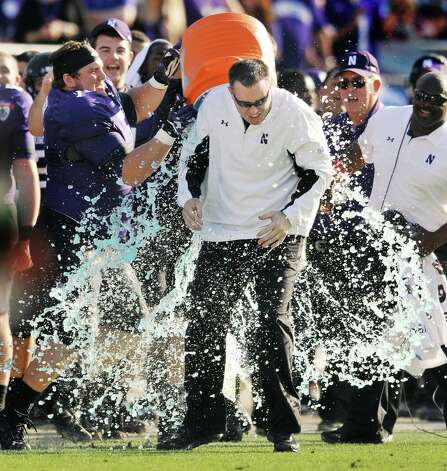 Northwestern coach Pat Fitzgerald is doused in the closing minute of the Wildcats 34-20 victory over Mississippi State in the Gator Bowl NCAA college football game, Tuesday, Jan. 1, 2013, in Jacksonville, Fla. Photo: Bob Self, Associated Press / The Flolrida Times-Union