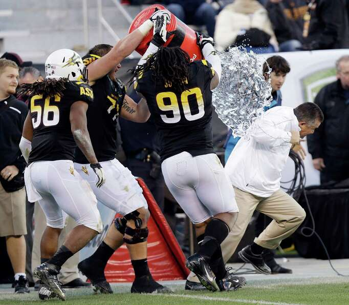 Arizona State head coach Todd Graham, right, is doused after a 62-28 win over Navy during the Fight