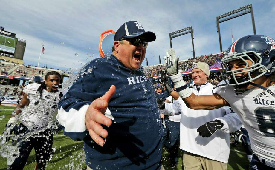 Rice head coach David Bailiff reacts after he is drenched in water by his players after the end of the Armed Forces Bowl NCAA college football game against Air Force, Saturday, Dec. 29, 2012, in Fort Worth, Texas. Rice won 33-14. Photo: LM Otero, Associated Press / AP