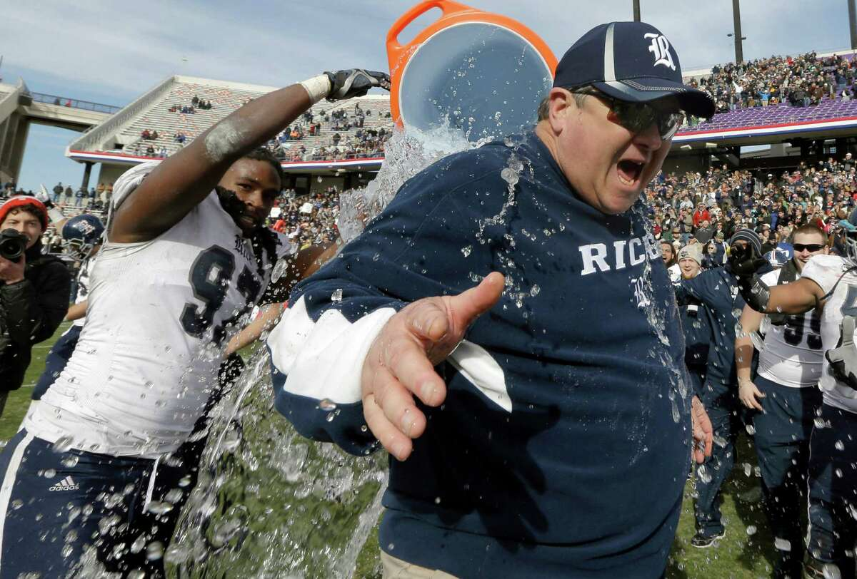 Rice head coach David Bailiff is drenched in water by defensive end Jared Williams (97) after the end of the Armed Forces Bowl NCAA college football game against Air Force, Saturday, Dec. 29, 2012, in Fort Worth, Texas. Rice won 33-14. (AP Photo/LM Otero)