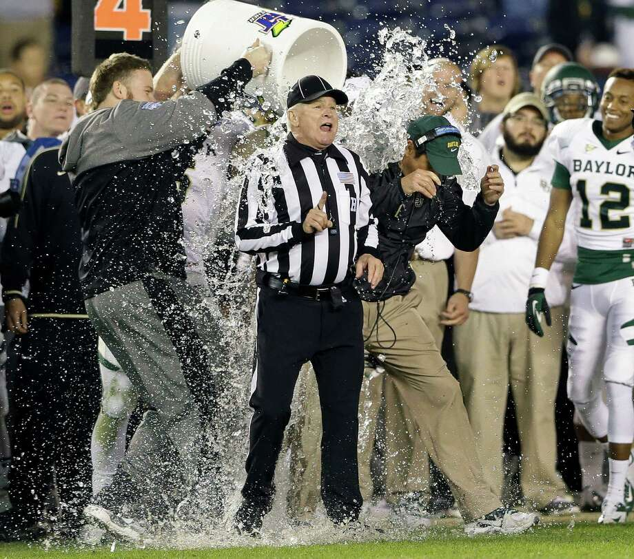 Baylor coach Art Briles is doused next to an official after Baylor defeated UCLA 49-26 in the Holiday Bowl NCAA college football game on Thursday, Dec. 27, 2012 in San Diego. Photo: Lenny Ignelzi, Associated Press / AP