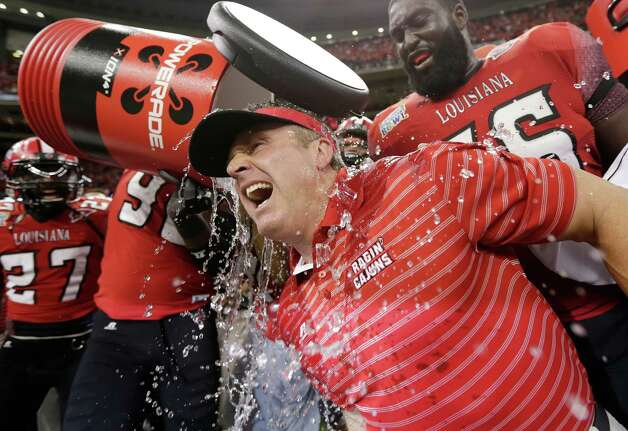 Louisiana-Lafayette head coach Mark Hudspeth is dunked at the end of a win over East Carolina in the New Orleans Bowl, an NCAA college football game in New Orleans, Saturday, Dec. 22, 2012. Louisiana-Lafayette beat East Carolina 43-34. Photo: Dave Martin, Associated Press / AP
