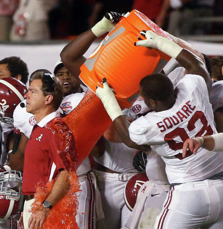 Alabama head coach Nick Saban is dunked with Gatorade in the final seconds of  the BCS National Championship college football game against Notre Dame Monday, Jan. 7, 2013, in Miami. Alabama won 42-14.  Photo: John Bazemore, Associated Press / AP