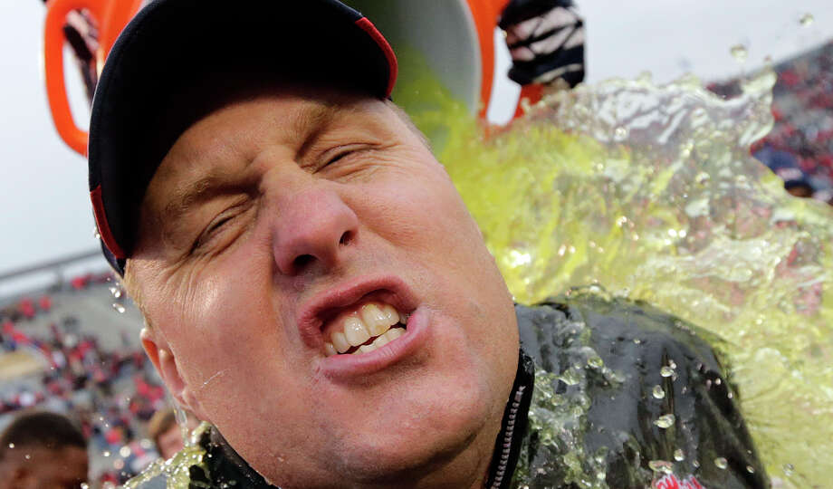 Some get damp, while others get completely drenched. Either way, dumping the team cooler over the coach's head after a win is a college football must. Here are the soakings from the 2012-13 bowl season.PHOTO: Mississippi head coach Hugh Freeze gets dunked at the end of the BBVA Compass Bowl NCAA college football game against Pittsburgh at Legion Field in Birmingham, Saturday, Jan. 5, 2013. Mississippi won 38-17. Photo: Dave Martin, Associated Press / AP