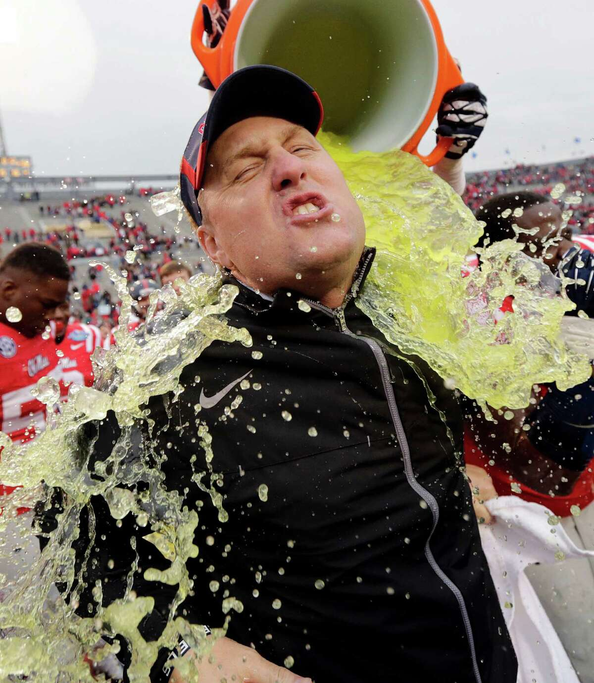 Mississippi head coach Hugh Freeze gets dunked after their 38-17 win over Pittsburgh in the BBVA Compass Bowl NCAA college football game against Pittsburgh at Legion Field in Birmingham, Ala., Saturday, Jan. 5, 2013.