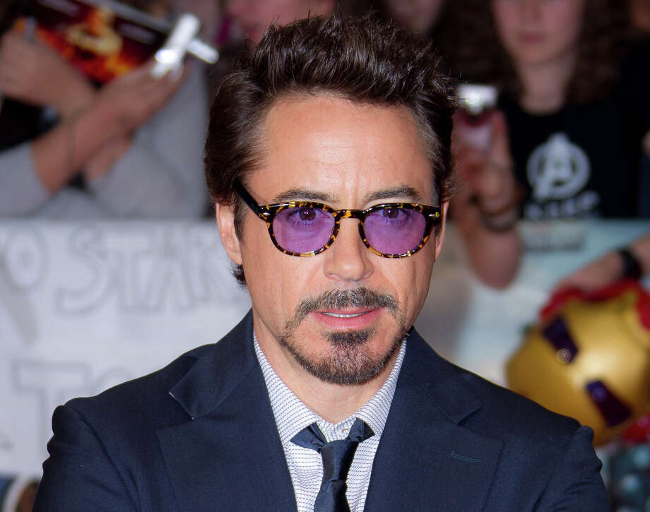 "Now: Actor Robert Downey Jr arrives for the European Premiere of ""The Avengers,"" in London on April 19, 2012. Photo: Joel Ryan, Associated Press / AP"
