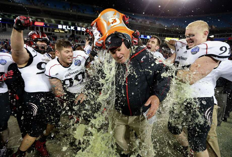 Interim head coach Steve Stripling of the Cincinnati Bearcats is dunked in Gatorade after defeating the Duke Blue Devils 48-34 during their game at Bank of America Stadium on December 27, 2012 in Charlotte, North Carolina. Photo: Streeter Lecka, Getty Images / 2012 Getty Images