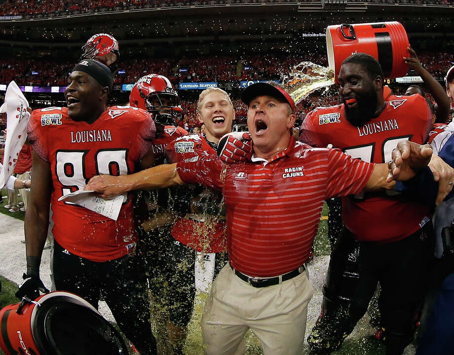 Head coach Mark Hudspeth of the Louisiana-Lafayette Ragin Cajuns is dunked with sports drink after defeating the East Carolina Pirates during the R+L Carriers New Orleans Bow at the Mercedes-Benz Superdome on December 22, 2012 in New Orleans, Louisiana. Photo: Chris Graythen, Getty Images / 2012 Getty Images