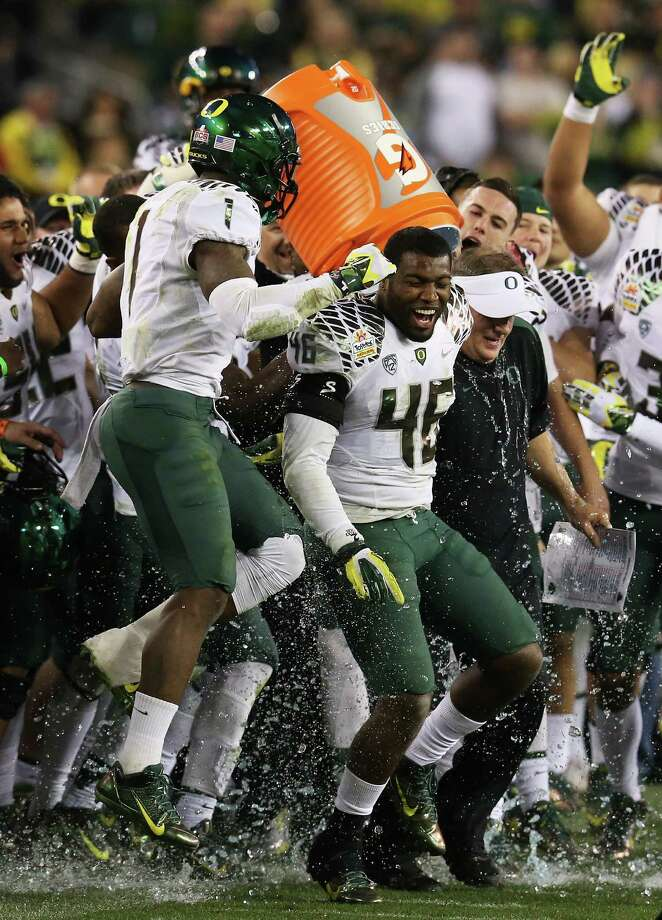 Michael Clay #46 and Bryan Bennett #2 dump the Gatorade cooler on head coach Chip Kelly of the Oregon Ducks after their 35 to 17 victory over the Kansas State Wildcats in the Tostitos Fiesta Bowl at University of Phoenix Stadium on January 3, 2013 in Glendale, Arizona. Photo: Stephen Dunn, Getty Images / 2013 Getty Images