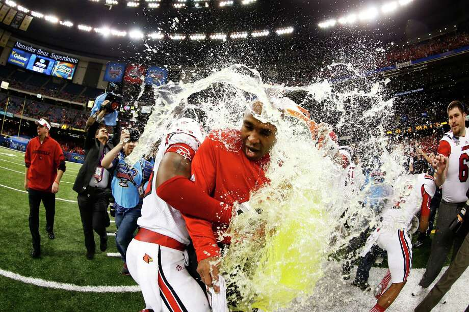 The Gatorade bucket is dumped on head coach Charlie Strong of the Louisville Cardinals after their 33 to 23 win over the Florida Gators in the Allstate Sugar Bowl at Mercedes-Benz Superdome on January 2, 2013 in New Orleans, Louisiana. Photo: Chris Graythen, Getty Images / 2013 Getty Images