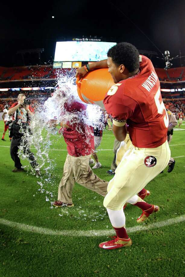 Jameis Winston #5 of the Florida State Seminoles dumps the Gatorade bucket on head coach Jimbo Fisher of the Florida State Seminoles after they won 31-10 against the Northern Illinois Huskies during the Discover Orange Bowl at Sun Life Stadium on January 1, 2013 in Miami Gardens, Florida. Photo: Mike Ehrmann, Getty Images / 2013 Getty Images
