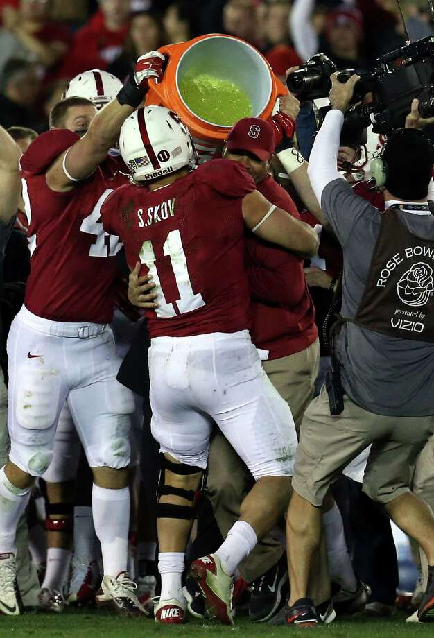 Head coach David Shaw of the Stanford Cardinal has Gatorade dumped on him as the Cardinal celebrate after defeating the Wisconsin Badgers 20-14 in the 99th Rose Bowl Game Presented by Vizio on January 1, 2013 at the Rose Bowl in Pasadena, California. Photo: Stephen Dunn, Getty Images / 2013 Getty Images