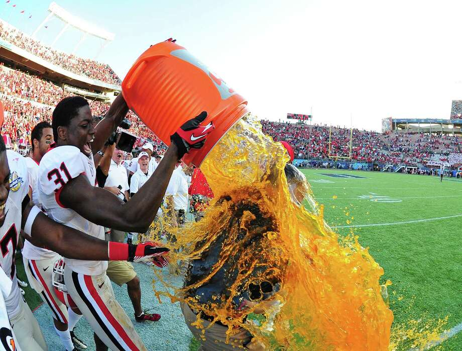 Head Coach Mark Richt of the Georgia Bulldogs is doused with Gatorade by Chris Conley #31 after the Capital One Bowl against the Nebraska Cornhuskers at the Citrus Bowl on January 1, 2013 in Orlando, Florida. Photo: Scott Cunningham, Getty Images / 2013 Getty Images