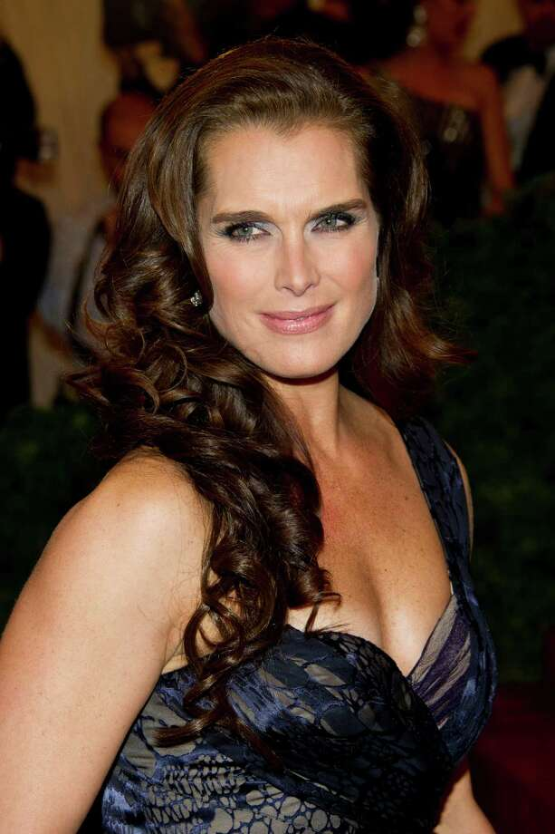 Now: Actress Brooke Shields arrives at the Metropolitan Museum of Art Costume Institute gala benefit, celebrating Elsa Schiaparelli and Miuccia Prada in New York on May 7, 2012. Photo: Charles Sykes, AP / AP2012