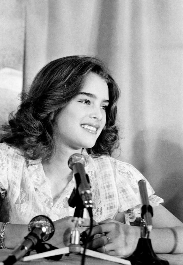 "Then: Actress/model Brooke Shields, 13,  is shown at a Cannes news conference, discussing the U.S. entry ""Pretty Baby,"" in which she plays a child prostitute, on May 22, 1978. Photo: Jean-Jacques Levy, AP / 1978 AP"