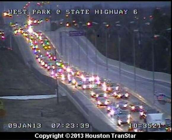 Traffic backed up at 7:23 a.m. Wednesday, Jan. 9, 2013,  on the Westpark Tollway at Highway 6. Photo: Houston Transtar