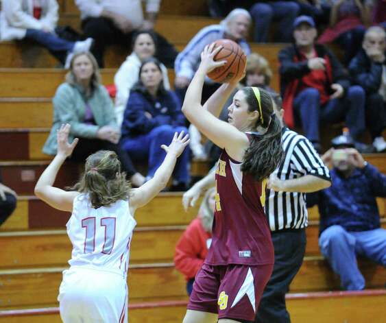 At left, Alexa Moses # 11 of Greenwich covers Erin Johnson of St. Joseph's during girls high school basketball game between Greenwich and St. Joseph at Greenwich High School, Tuesday night, Jan. 8, 2013. Photo: Bob Luckey / Greenwich Time