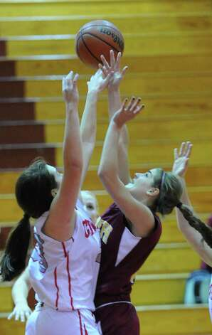 At right, Maite Gritsko # 25 of St. Joseph's rebounds the ball along with Jamie Kockenmeister of Greenwich during girls high school basketball game between Greenwich and St. Joseph at Greenwich High School, Tuesday night, Jan. 8, 2013. Photo: Bob Luckey / Greenwich Time