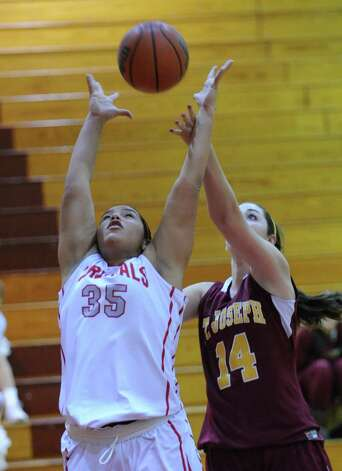 At left, Brittany Rodriquez # 35 of Greenwich rebounds the ball along with Erin Johnson # 14 of St. Joseph's during girls high school basketball game between Greenwich and St. Joseph at Greenwich High School, Tuesday night, Jan. 8, 2013. Photo: Bob Luckey / Greenwich Time