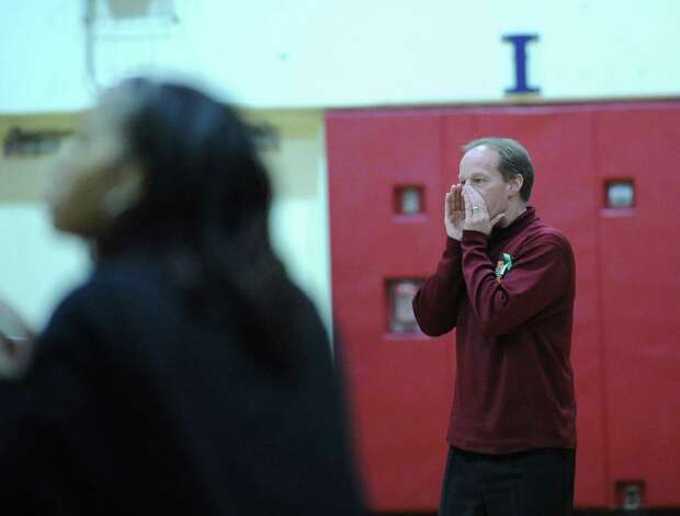 St. Joseph basketball coach Chris Lindwall, right, shouts instructions to his team during girls high school basketball game between Greenwich and St. Joseph at Greenwich High School, Tuesday night, Jan. 8, 2013. Photo: Bob Luckey / Greenwich Time