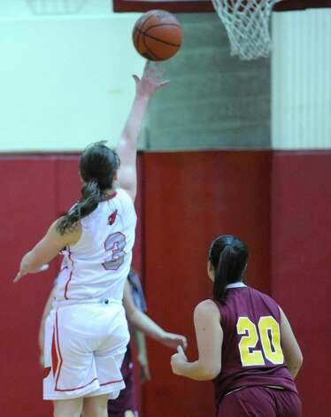 At left, Caroline Barrett #3  of Greenwich scores on a layup as Lauren Pitney # 20 of St. Joseph's looks on during girls high school basketball game between Greenwich and St. Joseph at Greenwich High School, Tuesday night, Jan. 8, 2013. Photo: Bob Luckey / Greenwich Time
