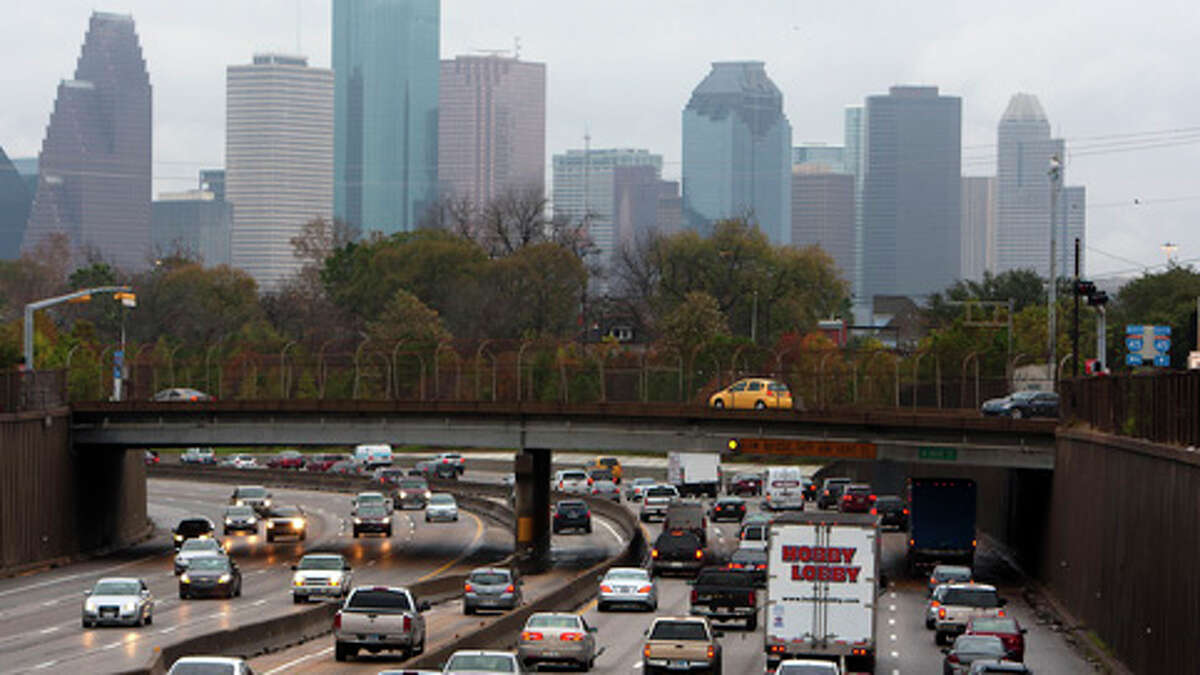 Traffic crawls along Interstate 45 south of downtown Houston on Jan. 9, 2013.