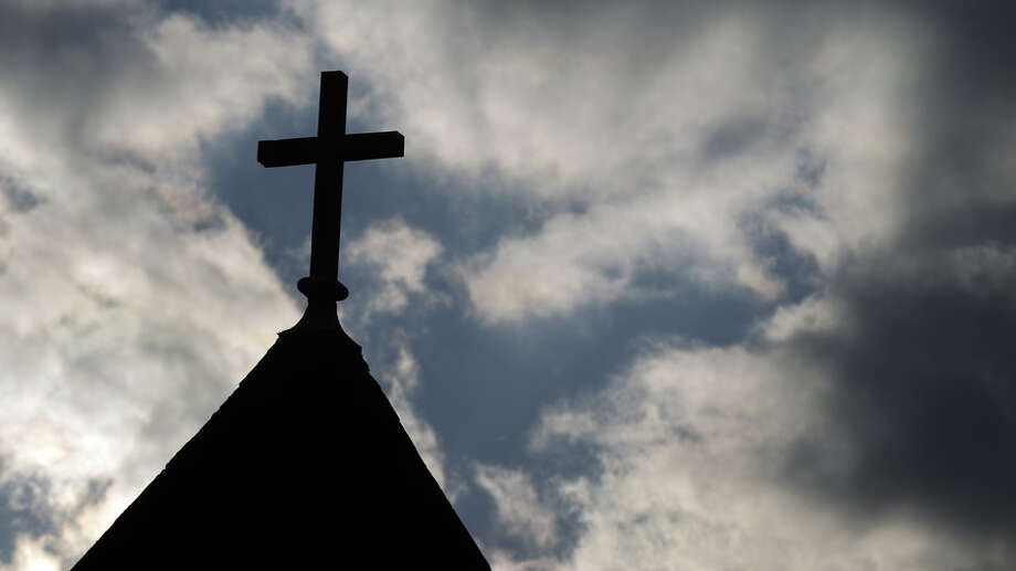 The cross on the steeple of St. Francis Xavier Catholic Church in Henryville, Ind. Photo: Michael Conroy, AP