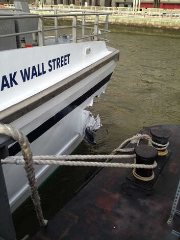 A hole is torn near the bow of the Seastreak Wall Street ferry after it banged into the mooring as it arrived at a pier in New York's financial district Wednesday, Jan. 9, 2013. Police and fire officials say 30 to 50 people were injured when the ferry struck a dock during the morning rush hour. Photo: AP