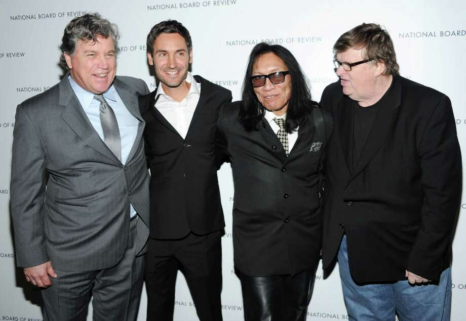 Sony Pictures Classics co-president Tom Bernard, left, director Malik Bendjelloul, musician Sixto Rodriguez and filmmaker Michael Moore, right, pose together at the National Board of Review Awards gala at Cipriani 42nd St. on Tuesday Jan. 8, 2013 in New York. Photo: Evan Agostini, Evan Agostini/Invision/AP / Invision