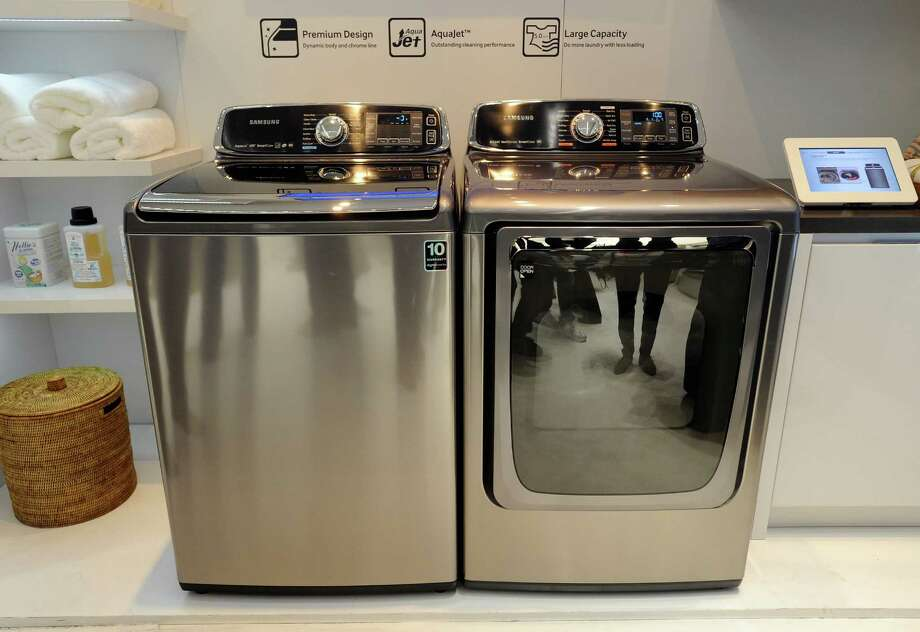 LAS VEGAS, NV - JANUARY 08:  Samsung's Smart Care washer and dryer are on display at the 2013 International CES at the Las Vegas Convention Center on January 8, 2013 in Las Vegas, Nevada. CES, the world's largest annual consumer technology trade show, runs through January 11 and is expected to feature 3,100 exhibitors showing off their latest products and services to about 150,000 attendees. Photo: David Becker, Getty Images / 2013 Getty Images