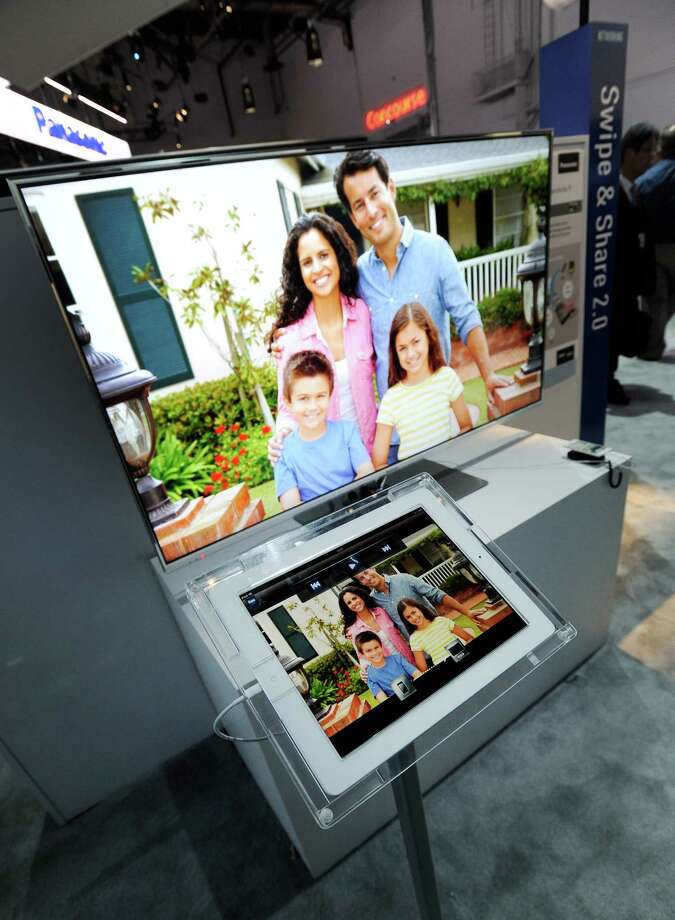 LAS VEGAS, NV - JANUARY 08:  Panasonic's Swipe & Share 2.0 is seen at the 2013 International CES at the Las Vegas Convention Center on January 8, 2013 in Las Vegas, Nevada. CES, the world's largest annual consumer technology trade show, runs through January 11 and is expected to feature 3,100 exhibitors showing off their latest products and services to about 150,000 attendees. Photo: David Becker, Getty Images / 2013 Getty Images