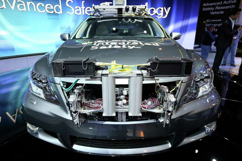 LAS VEGAS, NV - JANUARY 08:  A Lexus LS Integrated Safety self-driving car is displayed at the Lexus booth during the 2013 International CES at the Las Vegas Convention Center on January 8, 2013 in Las Vegas, Nevada. CES, the world's largest annual consumer technology trade show, runs from January 8-11 and is expected to feature 3,100 exhibitors showing off their latest products and services to about 150,000 attendees. Photo: Justin Sullivan, Getty Images / 2013 Getty Images