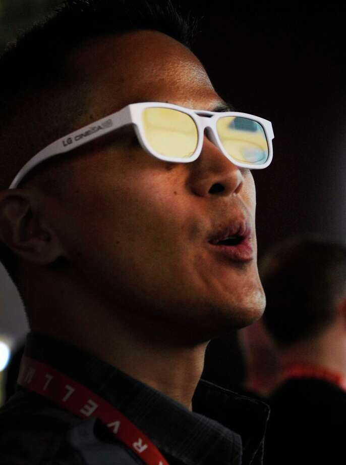 LAS VEGAS, NV - JANUARY 08:  An attendee watches a 3D video with special glasses at the LG booth at the 2013 International CES at the Las Vegas Convention Center on January 8, 2013 in Las Vegas, Nevada. CES, the world's largest annual consumer technology trade show, runs through January 11 and is expected to feature 3,100 exhibitors showing off their latest products and services to about 150,000 attendees. Photo: David Becker, Getty Images / 2013 Getty Images