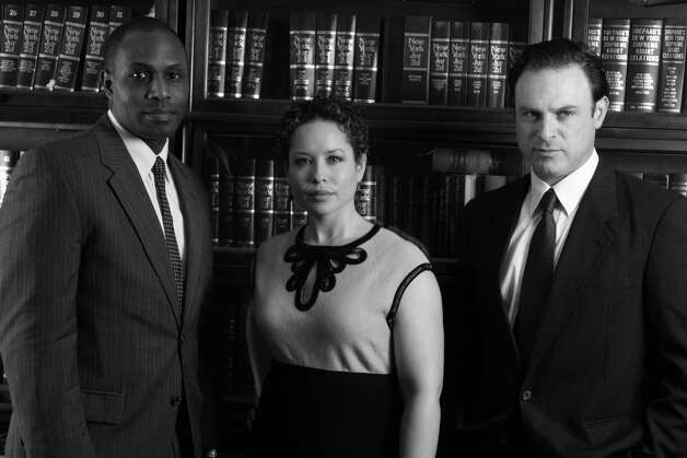 "Kevin Craig West, Shelly Thomas and J. Anthony Crane in ""Race,"" at Capital Repertory Theatre Jan. 11 through Feb. 10, 2013, in Albany. (Richard Lovrich)"
