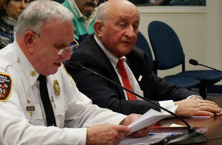 Fire Chief Richard Felner, left, and Fire Commission Chairman Richard Popilowski discuss firefighter pension procedures at Tuesday's Board of Finance meeting.   Fairfield CT 1/8/13 Photo: Genevieve Reilly / Fairfield Citizen