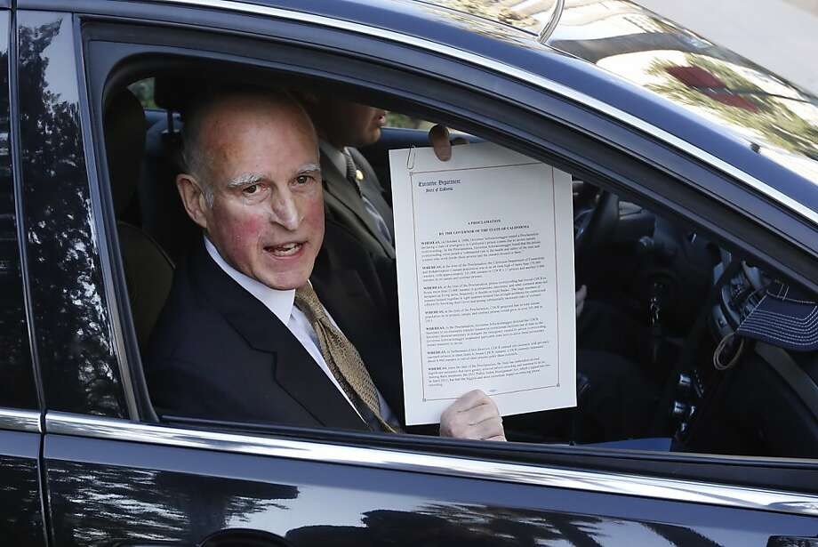 Gov. Jerry Brown displays proclamation declaring an end to prison overcrowding emergency. Photo: Rich Pedroncelli, Associated Press