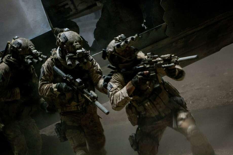 """A group of elite Navy SEALs prepares to raid Osama bin Laden's compound in Abbottabad, Pakistan, in """"Zero Dark Thirty."""" Photo: Jonathan Olley, Unit Stills / ©2012 Zero Dark Thirty, LLC.  All Rights Reserved."""