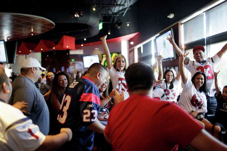 Expect a rowdy group of Texans fans to gather at the Houston Texans Grille on game day. A seat at this sports bar, located in CityCentre, is one of the most sought after in the city for a true Texans fan. Photo: TODD SPOTH, Photographer / Todd Spoth