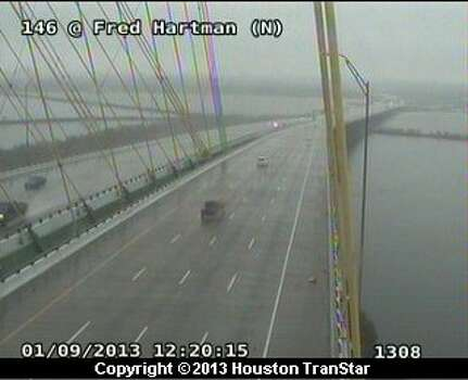 Rain falls on traffic on the Fred Hartman Bridge at SH 146 at 12:20 p.m. Wednesday, Jan. 9, 2013. Photo: Houston Transtar