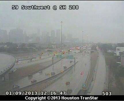 Rain falls on traffic on the Southwest Freeway at SH 288 at 12:16 p.m. Wednesday, Jan. 9, 2013. Photo: Houston Transtar