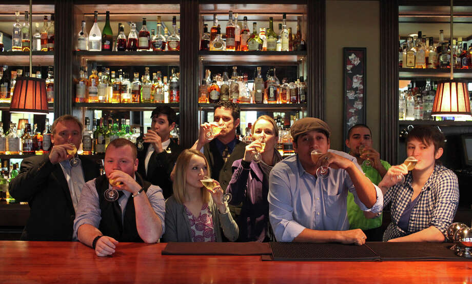 Mike Rilley, General Manager at the Majestic Theatre, from left, Breck Cowen, Soho, Jake Corney, head bartender at Bohanan's, Sierra Segura, Tre Trattoria Downtown, Don Marsh, owner of Bar 1919, Jenny Rabb, Bohanan's and conference planner, Jeret Pena, owner of the Brooklynite, Leo Rodriguez, La Margarita, and Karah Carmack, The Esquire Tavern, at Bohanan's in San Antonio on Tuesday, Jan. 8, 2012. Photo: Lisa Krantz, San Antonio Express-News / © 2012 San Antonio Express-News