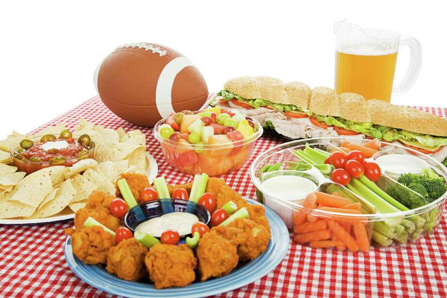 Table spread with appetizer trays for the footbal party.  Horizontal view over white background. (Fotolia) Photo: Lisa F. Young / Lisa F. Young - Fotolia