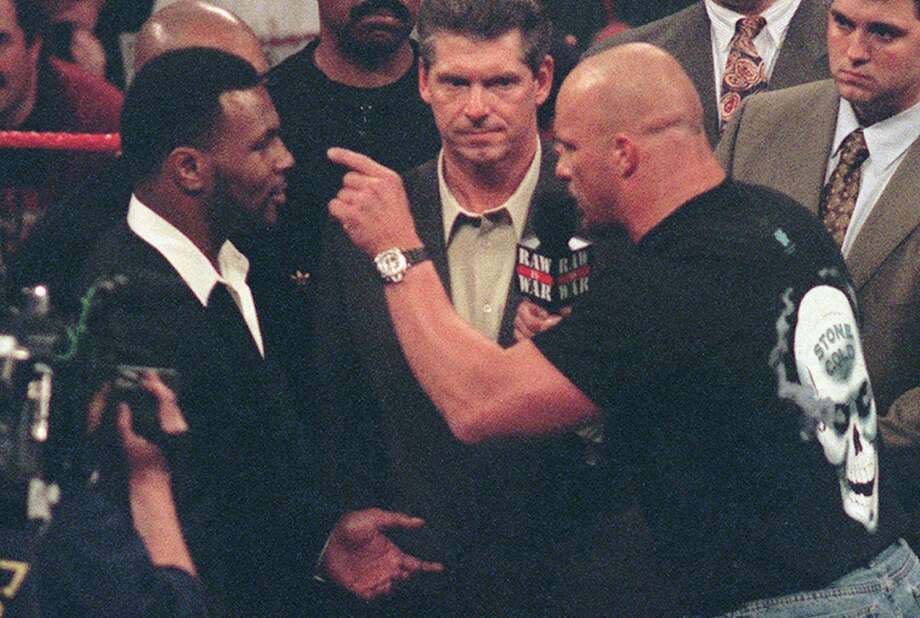 Stone Cold Steve Austin challenged Mike Tyson, but the two were working together all along. Tyson helped Austin win the WWF title from Shawn Michaels at Wrestlemania 14.  Photo: ERIC PAUL ZAMORA, AP / AP