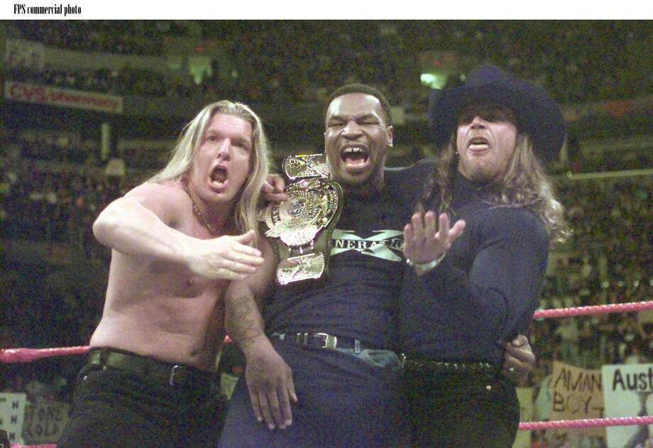 Iron Mike Tyson joined Triple HHH (left) and Shawn Michaels as a part of DX on March 2, 1998.  Photo: RICH FREEDA, FPS / WORLD WRESTLING FEDERATION