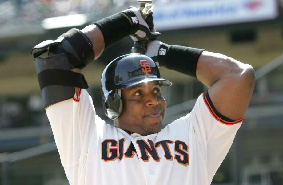 San Francisco Giants' Barry Bonds warms up in the on deck circle before batting against the Houston Astros in the third inning of the first baseball game of a double header in San Francisco, Thursday, April 13, 2006. (AP Photo/Jeff Chiu) Photo: JEFF CHIU / AP