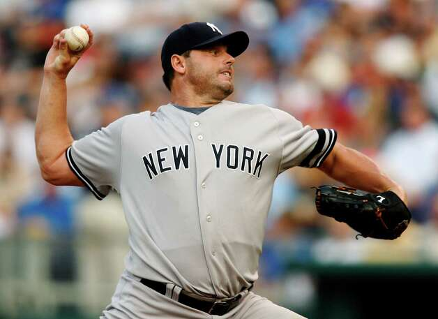 FILE - In this July 23, 2007, file photo, New York Yankees starting pitcher Roger Clemens throws against Kansas City Royals' David DeJesus in the first inning of a baseball game in Kansas City, Mo. With the cloud of steroids shrouding the candidacies of Barry Bonds, Sammy Sosa and Clemens, baseball writers on Wednesday, Jan. 9 ,2013, might not elect anyone to the Hall of Fame for only the second time in four decades. (AP Photo/Ed Zurga, File) Photo: Ed Zurga / AP