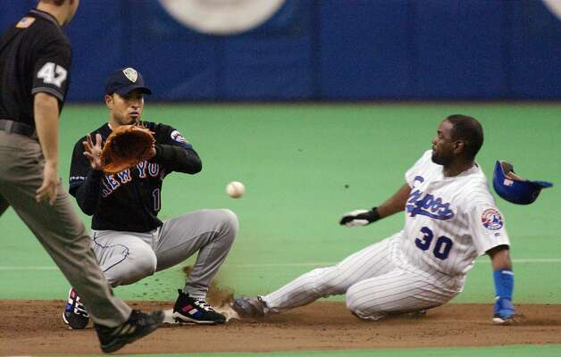 Montreal Expos' Tim Raines steals second base ahead of the throw to New York Mets' Rey Ordonez during the sixth inning on Tuesday  September 25, 2001 in Montreal. (AP PHOTO/Marcos Townsend) Photo: MARCOS TOWNSEND / AP