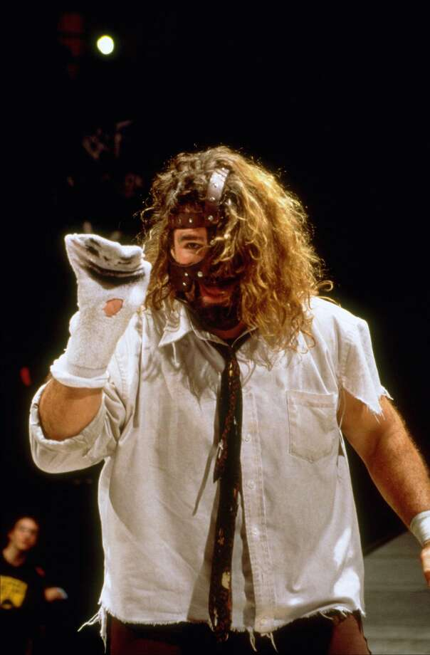 Mankind was known for putting his body on the line like no one else. He is best known for being thrown off the Hell in the Cell and being slammed through the ring. Photo: 1999 Titan Sports Inc., UPN